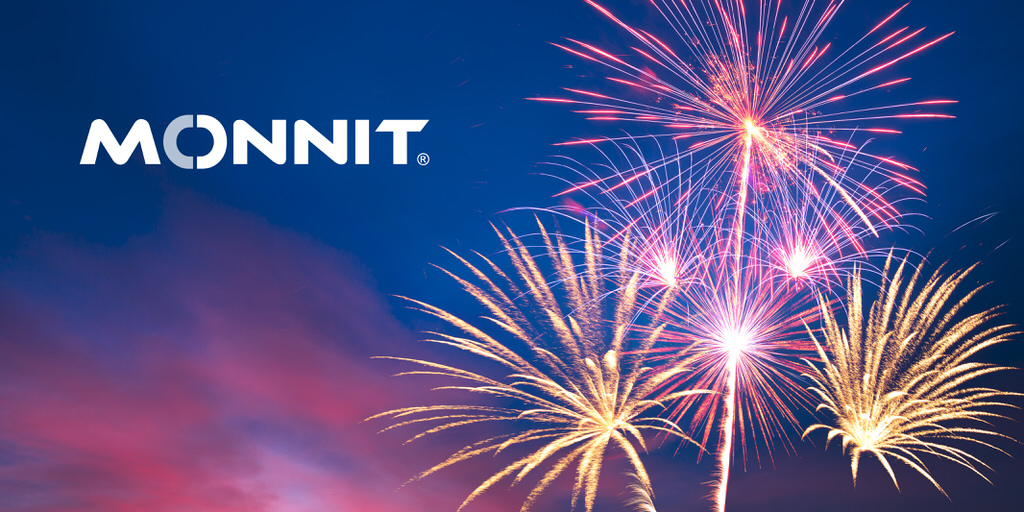Monnit logo with fireworks over a colorful sunset sky in the background