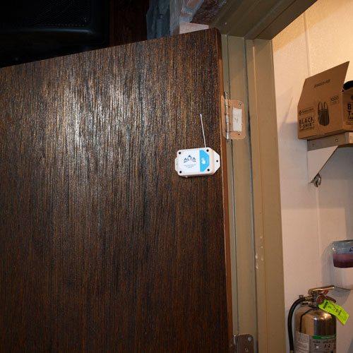 wireless button press sensor on door